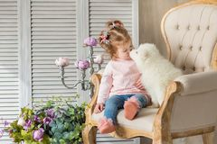 Free Blond Girl Posing With Husky Puppy White Color In Retro Studio Shoot With Royal Armchair. Cute Young Child Play With Puppy Dogs In Stock Image - 132273381