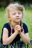 Blond girl praying Stock Photography