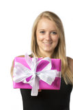 Blond girl with present Royalty Free Stock Images