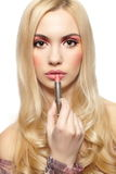 Blond girl with pretty pink makeup with lipstick Royalty Free Stock Images