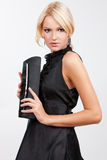 Blond girl with a purse Royalty Free Stock Photography