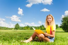 Blond girl reading Stock Photography
