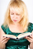 Blond girl reads big book Stock Image