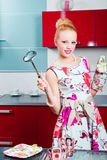 Blond girl ready for cooking Royalty Free Stock Photo