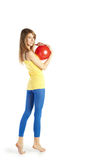 Blond girl with red ball Stock Image