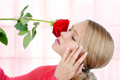 Blond girl with a red rose Stock Photo