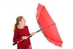 Blond girl with red umbrella. In frontof white background Royalty Free Stock Photography