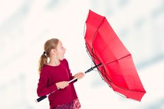 Blond girl with red umbrella. In frontof white background Stock Photography