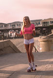 Blond girl on roller skates Royalty Free Stock Photo