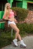 Blond girl on roller skates Royalty Free Stock Image
