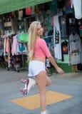 Blond girl on roller skates Stock Images