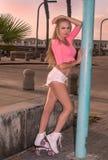 Blond girl on roller skates Stock Photos