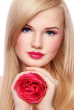 Blond girl with rose Stock Photos