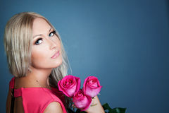 Blond girl with roses Stock Photography