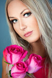 Blond girl with roses Stock Photos