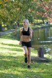 Blond girl running Stock Image