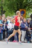 Blond girl running in red shirt Stock Photo