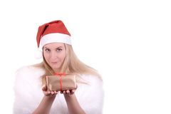Blond girl in Santa hat with gift Royalty Free Stock Photos