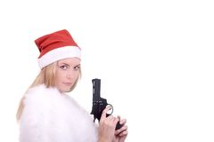 Blond girl in Santa hat with gun Royalty Free Stock Photo