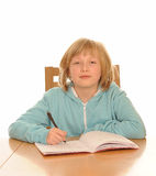 Young girl with homework stock photo