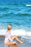 Blond girl on a sea beach Stock Photos