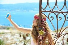 Blond girl selfie photo in mediterranean sea gate Stock Photos