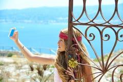 Blond girl selfie photo in mediterranean sea gate Royalty Free Stock Photo