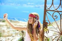 Blond girl selfie photo in mediterranean sea gate Royalty Free Stock Photography
