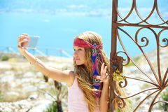 Blond girl selfie photo in mediterranean sea gate Royalty Free Stock Photos