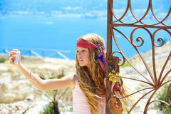 Blond girl selfie photo in mediterranean sea gate Stock Photo