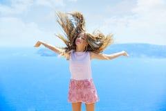 Blond girl shaking hair on air at blue Mediterranean Royalty Free Stock Photos