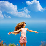 Blond girl shaking hair on air at blue Mediterranean Royalty Free Stock Image