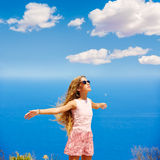 Blond girl shaking hair on air at blue Mediterranean Royalty Free Stock Photo