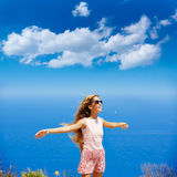 Blond girl shaking hair on air at blue Mediterranean Stock Images