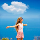 Blond girl shaking hair on air at blue Mediterranean Royalty Free Stock Photography