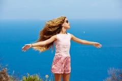 Blond girl shaking hair on air at blue Mediterranean Stock Image