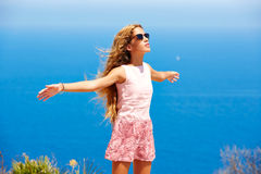Blond girl shaking hair on air at blue Mediterranean Royalty Free Stock Photo