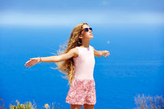Blond girl shaking hair on air at blue Mediterranean Stock Photography