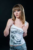 Blond girl in shirt and jeans Royalty Free Stock Image