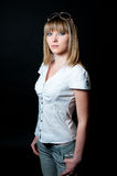 Blond girl in shirt and jeans Royalty Free Stock Photos