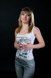 Blond girl in shirt and jeans Royalty Free Stock Images