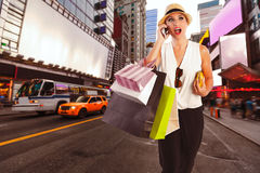 Blond girl shopaholic talking phone Times Square Royalty Free Stock Photos