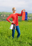 Blond Girl With Shopping Bags Stock Photo