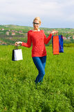 Blond Girl With Shopping Bags Stock Images