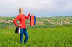 Blond Girl With Shopping Bags Royalty Free Stock Images