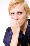 Blond girl with short hair looking sad. Studio portrait of a sad looking short haired blond girl royalty free stock photos