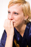 Blond girl with short hair in tears Stock Photo