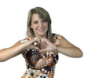 Blond girl showing heart symbol with two hands Royalty Free Stock Image