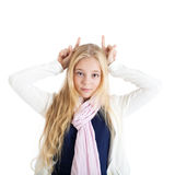 Blond girl showing horns. Royalty Free Stock Images