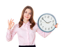 Blond girl showing ok okay success hand sign gesture isolated on. White.Businesswoman holding clock.Wall Clock.Time Stock Photos